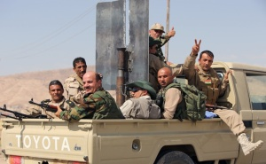 616x380_peshmergas-combattants-kurdes-celebrent-reprise-barrage-mossoul-djihadistes-etat-islamique