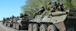 Russian servicemen drive armoured personnel carriers on the outskirts of the city of Belgorod