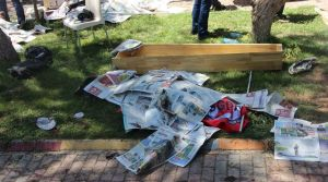 the-body-of-a-victim-covered-by-newspapers-lies-next-to-a-coffin-after-an-explosion-in-suruc-in-the-southeastern-sanliurfa-province_5385407