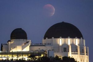 a-supermoon-is-seen-in-the-sky-above-griffith-park-observatory-in-los-angeles-california_5426937
