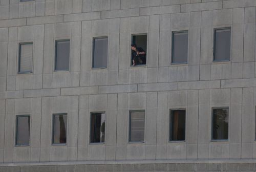 iranian-policeman-looks-out-of-the-parliament-s-building-in-central-tehran_5893195